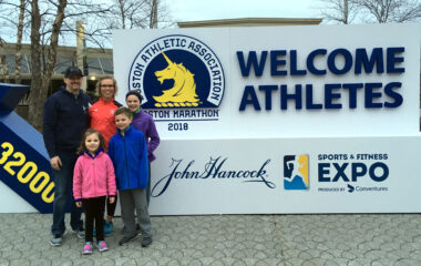 Alison Jones and family pictured at the Welcome Athletes sign in Boston.